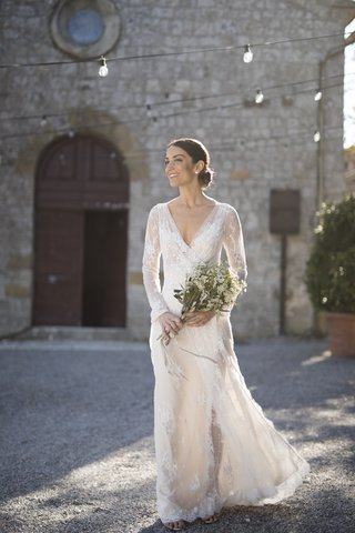 bride-in-inbal-dror-lace-wrap-dress-with-v-neck-and-long-sleeves-in-tuscany-courtyard