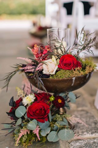 wine-colored-flowers-and-green-moss-inside-a-rustic-brown-vase-with-sage-and-olive-greenery-candles