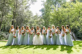 bride-in-a-line-wedding-dress-with-bridesmaids-in-light-blue-dresses-high-neck-floor-length