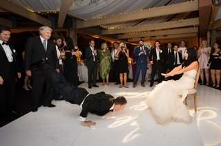 groom-does-the-worm-to-his-bride-for-the-garter-toss