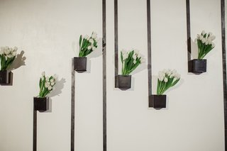 black-box-vase-on-wall-with-white-tulips-and-black-lines-modern-wedding-decor