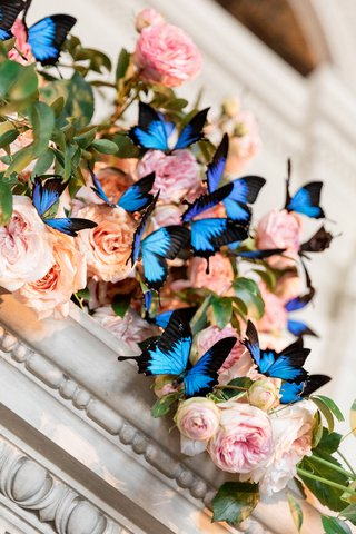mantle-decorated-with-pink-and-peach-roses-with-blue-papillio-ulysses-butterflies