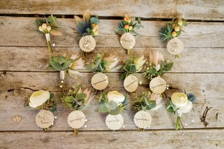 collection-of-rustic-chic-boutonnieres-with-sea-holly-roses-and-orange-buds