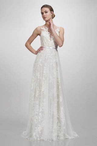 a-gown-with-an-illusion-bateau-neckline-a-thin-belt-a-tulle-skirt-and-floral-detailing-throughout
