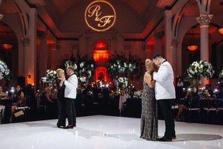 same-sex-wedding-inspiration-both-grooms-sharing-mother-son-dances-on-white-dance-floor
