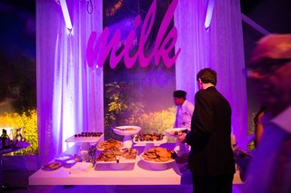 purple-lighting-at-cookies-and-milk-bar-tent-wedding-reception