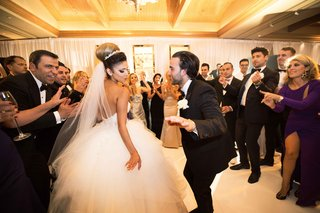 newlyweds-share-dance-floor-guests-white-ball-gown-fun-reception-black-tuxedo-pelican-hill