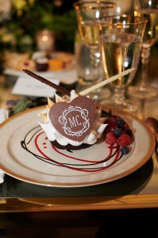 gourmet-chocolate-dessert-with-monogram-raspberries-and-blueberries