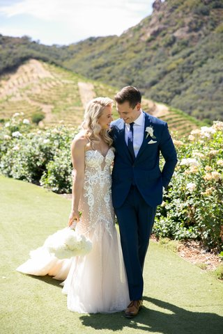 bride-in-pallas-couture-gown-with-blush-nude-lining-groom-in-navy-burberry-suite-vineyard