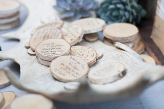 well-wishes-for-the-bride-and-groom-on-small-tree-branch-stumps-saucers-coasters-rustic