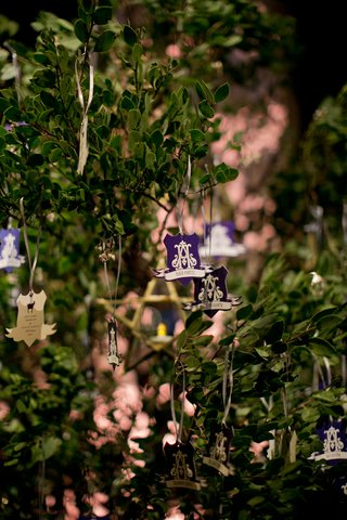 greenery-tree-with-escort-cards-hanging-from-it-old-world-fantasy-theme-hunter-pence-and-alexis