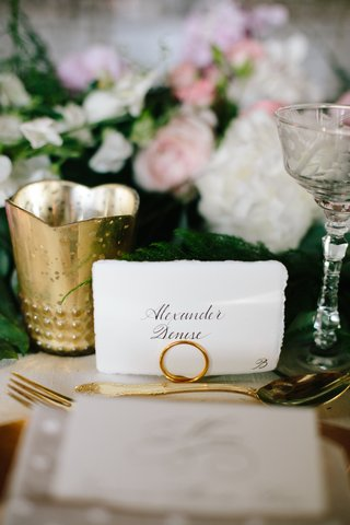 white-place-card-escort-card-with-calligraphy-name-and-natural-torn-edge-gold-flatware-and-candle