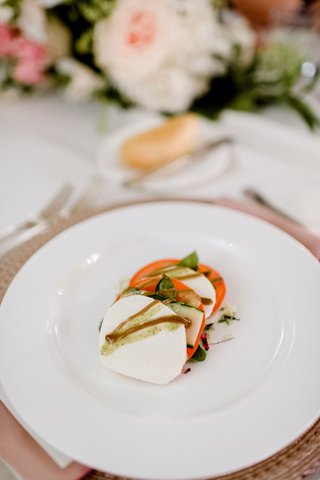 wedding-reception-food-mozzarella-cheese-basil-tomato-and-balsamic-glaze-on-white-plate