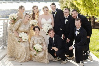 bride-in-strapless-sweetheart-watters-wedding-dress-groom-in-michael-kors-tux-bridesmaids-in-gold
