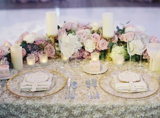wedding-reception-sweetheart-table-with-fabric-flower-tablecloth-pink-and-purple-flowers