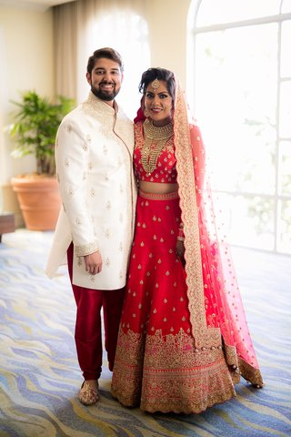 bride-and-groom-in-traditional-indian-wedding-attire-bride-in-lehnga-and-groom-in-sherwani