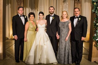mother-of-bride-in-v-neck-gold-floor-length-gown-and-mother-of-groom-in-grey-lace-off-shoulder-dress