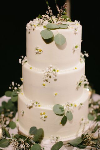 three-layer-wedding-cake-vegan-with-fresh-greenery-and-flowers-white-with-yellow-centers