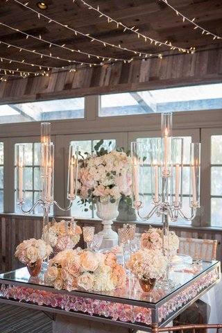 wedding-reception-square-sweetheart-table-crystals-pink-flower-petals-candelabra-crystal-lucite