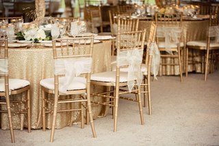 gold-chivari-chairs-with-sheer-white-bows-sequin-gold-linens