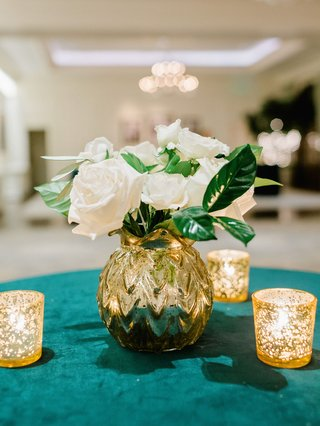 cocktail-hour-table-emerald-green-velvet-linen-gold-vase-white-roses-green-leaves-candles