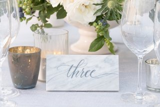 marble-tile-with-grey-calligraphy-marking-table-numbers