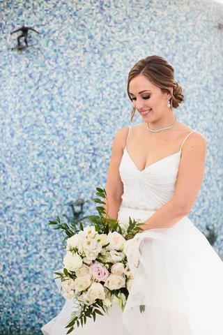 wedding-portrait-of-bride-v-neck-wedding-dress-necklace-hair-low-bun-ivory-bouquet-flowers-by-cina