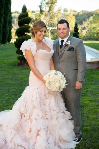 bride-in-mark-zunino-blush-ruffle-dress-and-groom-in-grey-suit-and-converse-sneakers