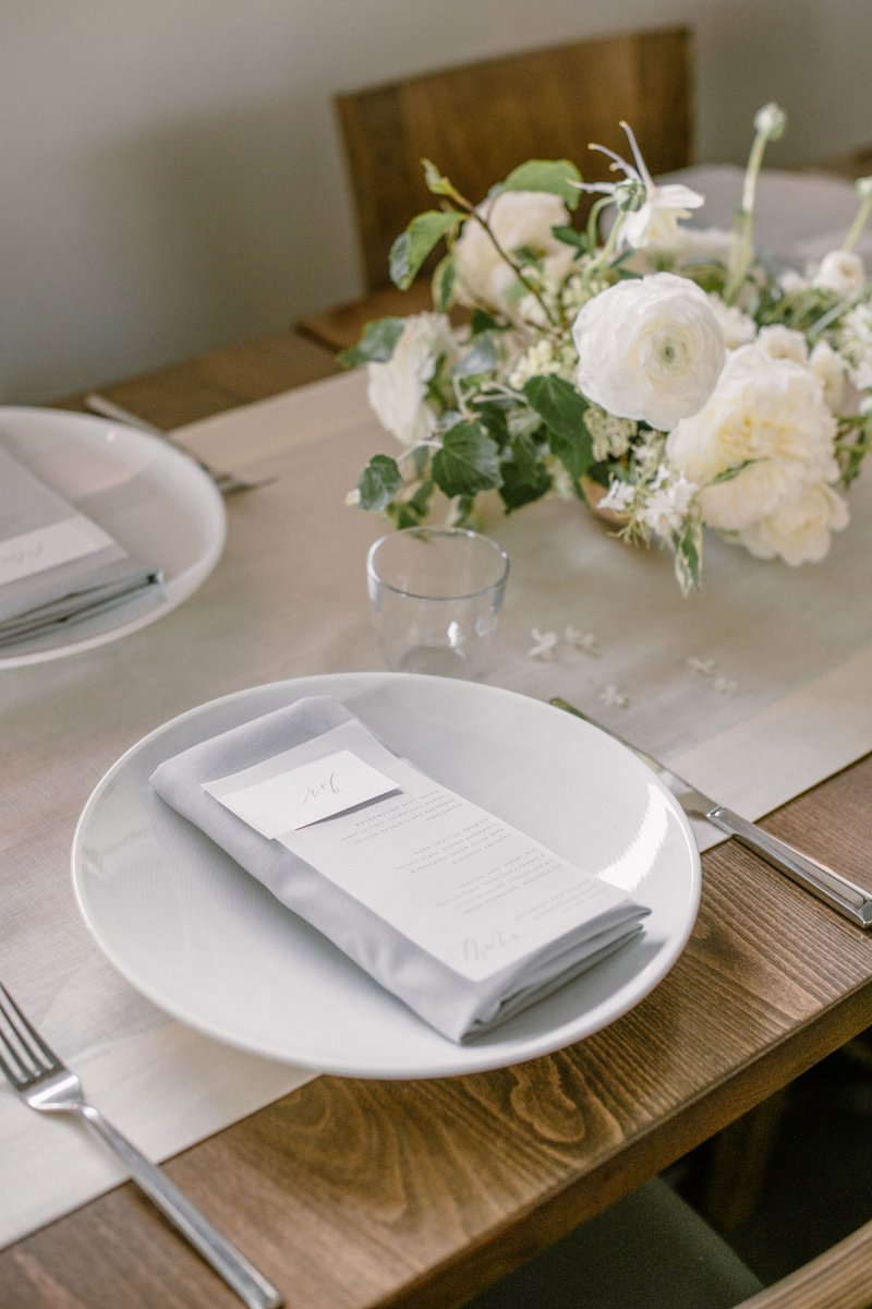 White Place Setting on Neutral Table
