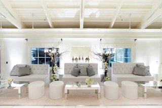 winter-wedding-lounge-area-with-white-tufted-furniture-silver-sequin-pillows-and-mirror-tables