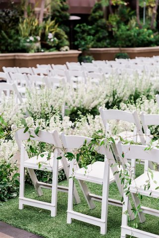 wedding ceremony at the four seasons los angeles at beverly hills white fold out chairs greenery