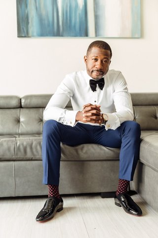 groom-in-blue-pants-white-shirt-bow-tie-burgundy-socks-with-white-polka-dots