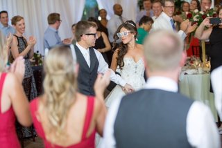 bride-in-alfred-angelo-gown-groom-in-dark-navy-grey-suit-vest-grand-entrance-novelty-sunglasses