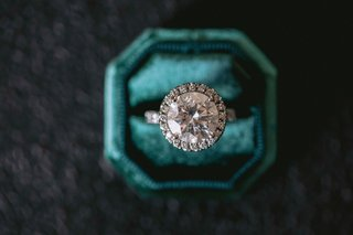wedding-ring-engagement-ring-in-velvet-teal-ring-box-large-round-diamond-halo-setting