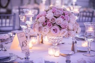 wedding reception low centerpiece pink ivory rose flowers arrangement with lavender lighting