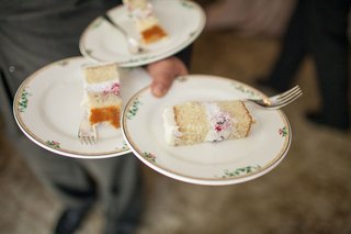 slices-of-cake-from-joanie-leighs-cakes-at-bridal-shower-on-small-china-plates