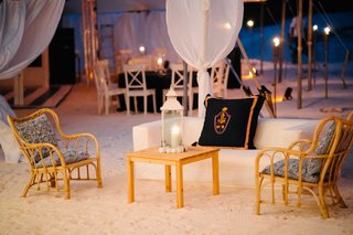 lounge-area-at-wedding-reception-on-white-sand-beach-under-tent-on-harbour-island-in-the-bahamas