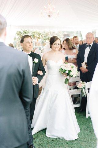 brides-dad-escorting-down-aisle-tented-south-carolina-wedding-historic-estate-sleek-dress
