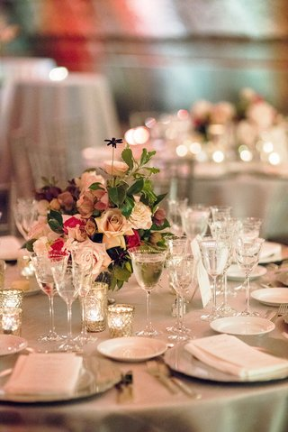 round-table-with-crystal-glassware-candle-votives-low-flower-arrangement-pink-roses-green-leaves