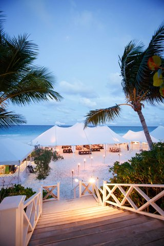 stairway-to-beach-tent-wedding-tiki-torch-candle-lights-on-sand-leading-to-reception-in-the-bahamas
