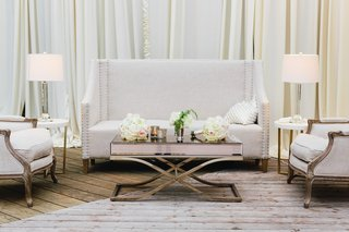 wedding-reception-cocktail-hour-long-furniture-white-settee-and-arm-chair-with-lamps-side-tables