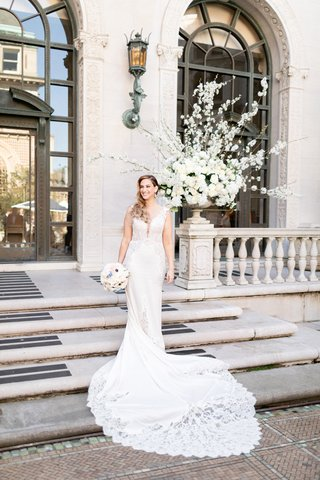 bride-in-pnina-tornai-wedding-dress-with-lace-cutouts-and-inserts