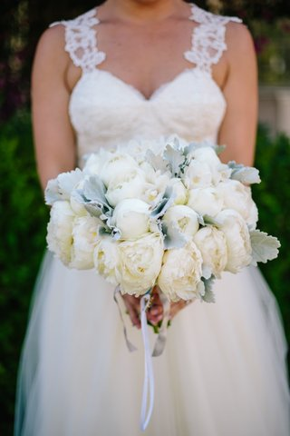 bride-in-winnie-couture-holding-bouquet-of-cream-peonies-and-dusty-miller