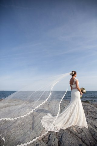 brides-lela-rose-veil-is-picked-up-by-the-wind-in-newport-ri