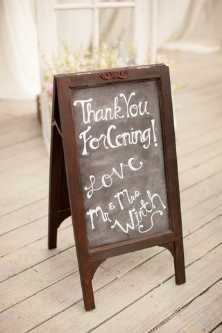 standing-chalkboard-sign-with-note-from-couple
