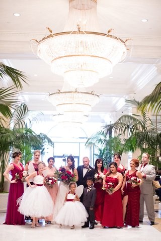 bride-in-hayley-paige-flower-girls-with-fairy-wings-mismatched-bridesmaids-bridesmen