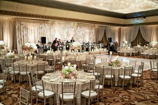 wedding-reception-with-silver-chiavari-chairs-white-pink-and-green-centerpieces-band-draping