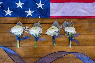 red-white-and-blue-boutonniere-american-flag-background