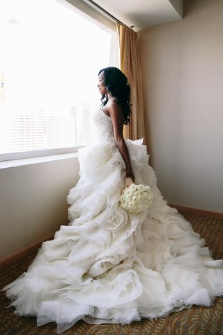 lazaro-bridal-gown-with-ruffled-skirt-and-bouquet