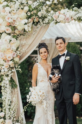 bride-and-groom-under-chuppah-with-little-pomeranian-pup-dog-puppy-in-tuxedo-outfit